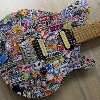 Design & Umbau einer MusicMan Axis zur Stickerbomb E-Gitarre
