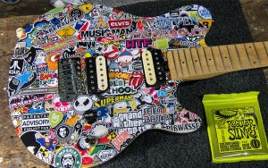 Musicman Axis Stickerbomb Saiten